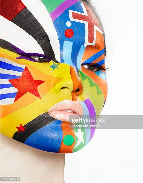 Multiple flag designs painted on woman's face