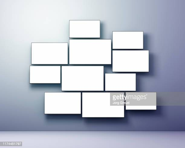 multiple flat screen tvs in various sizes - abundance stock pictures, royalty-free photos & images