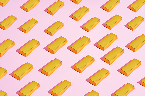 multiple gold bars placed in a pattern on a colored background - gettyimageskorea