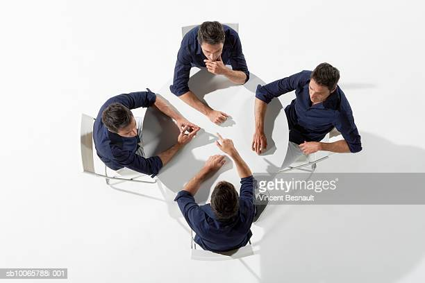 multiple image of man sitting at table - cloning stock pictures, royalty-free photos & images