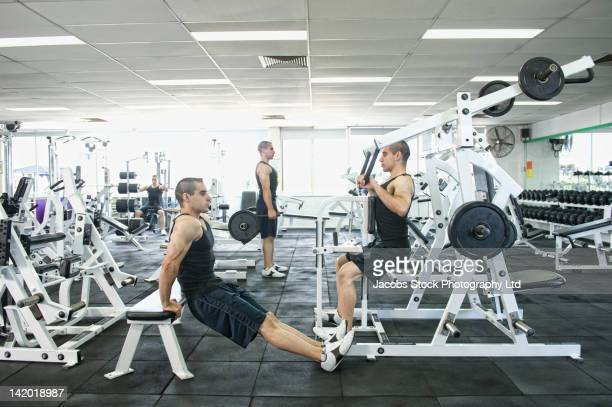 multiple image of middle eastern man exercising in health club - multiple exposure sport stock pictures, royalty-free photos & images