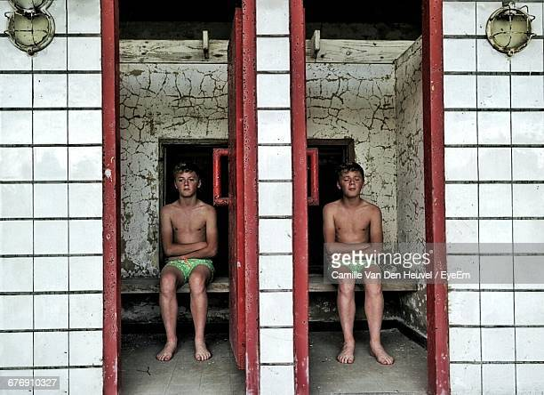 Multiple Image Of Shirtless Boy Sitting In Waiting Room