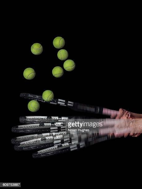 Multiple image of tennis racket hitting ball