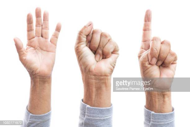 multiple image of woman hands gesturing against white background - apontando sinal manual - fotografias e filmes do acervo