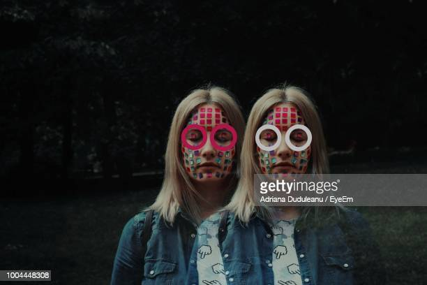 Multiple Image Of Woman With Decorations On Face