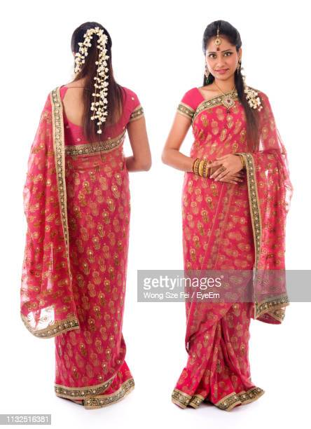 multiple image of young woman wearing red sari standing against white background - traditional clothing stock pictures, royalty-free photos & images