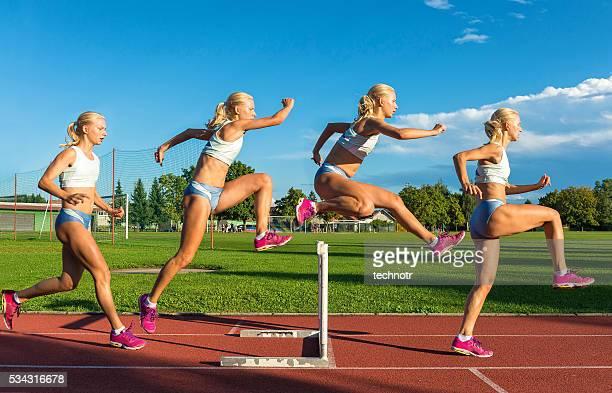 Multiple Image of  Young Women Racing 100m Hurdles
