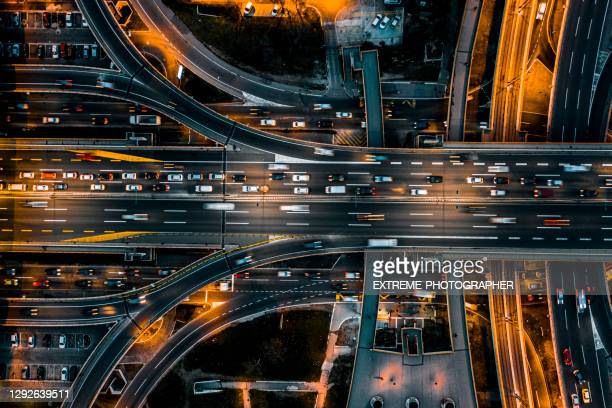 multiple lane road intersection seen at night directly from above - serbia stock pictures, royalty-free photos & images