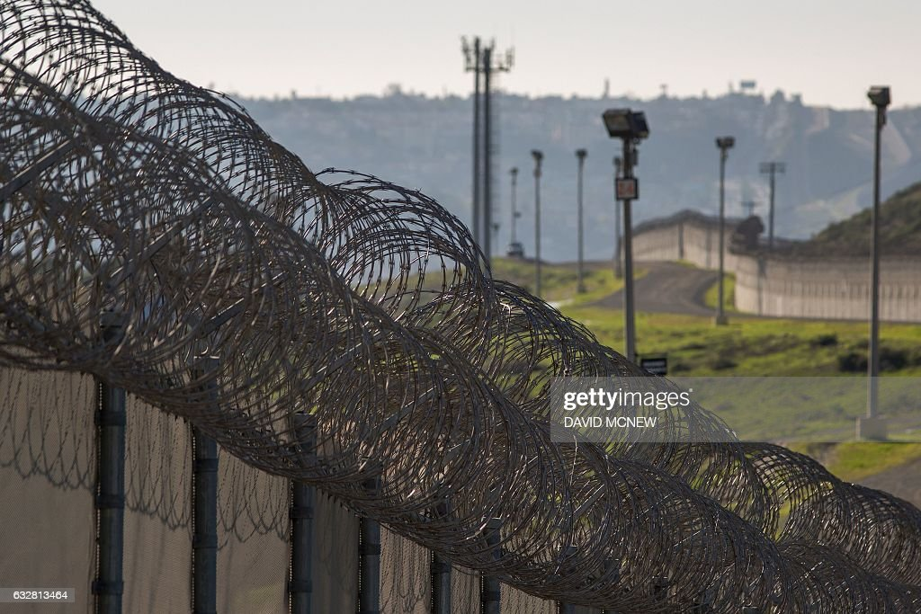 Multiple layers of steel walls, fences, razor wire and other ...