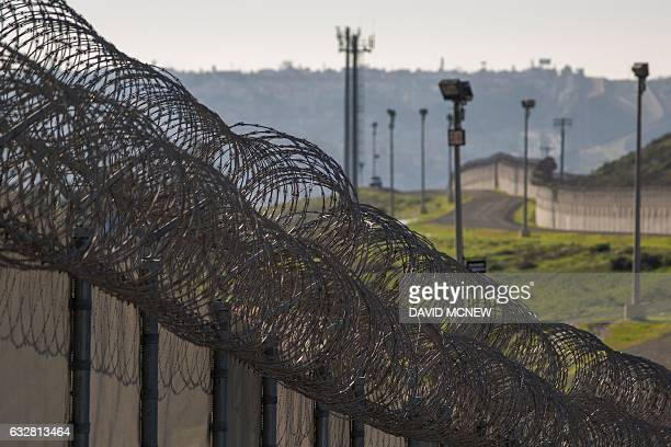 Multiple layers of steel walls fences razor wire and other barricades are viewed from the United States side of the US Mexico border on January 26...