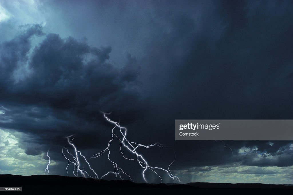 Multiple lightning bolts over rural landscape : Stockfoto