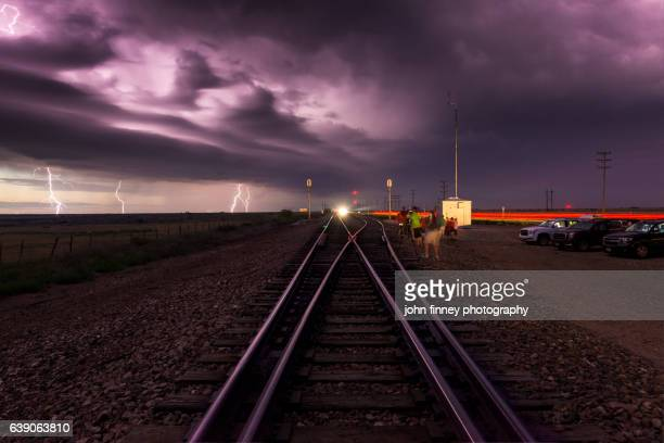 multiple lightning strikes over railway tracks in channing, texas. usa - country texas lightning stock pictures, royalty-free photos & images