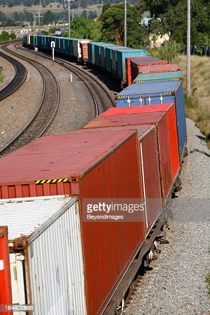 Multiple multicolored containers of a container train