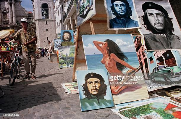 Multiple paintings of Argentineborn Cuban revolutionary Ernesto Che Guevara is put for sale along with other paintings 09 October in downtown Havana...