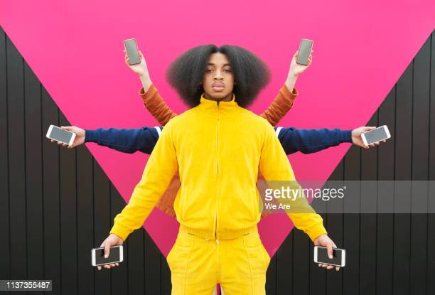 multiple people holding phones out at arms length - youth culture stock pictures, royalty-free photos & images