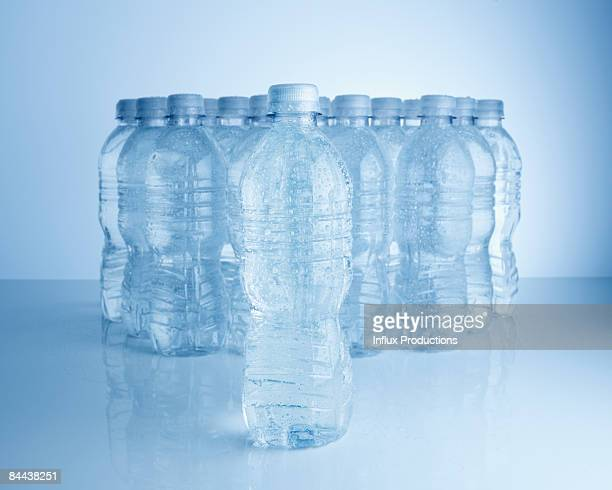 Multiple plastic bottles of water