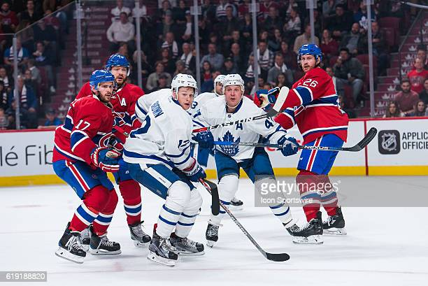 = multiple players looking at the puck away from them Toronto Maple Leafs Right Wing Connor Brown Toronto Maple Leafs Left Wing Leo Komarov Montreal...