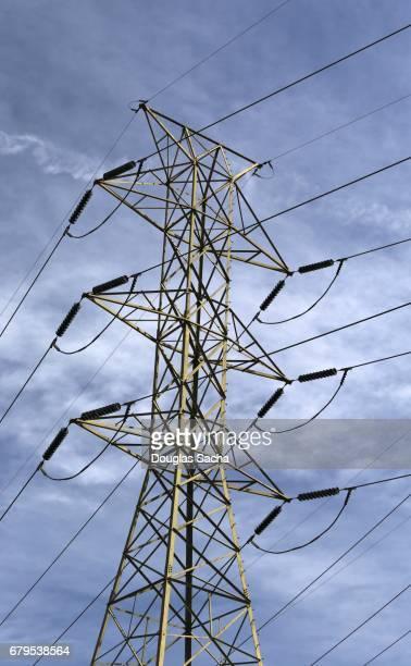 Multiple power lines on overhead tower
