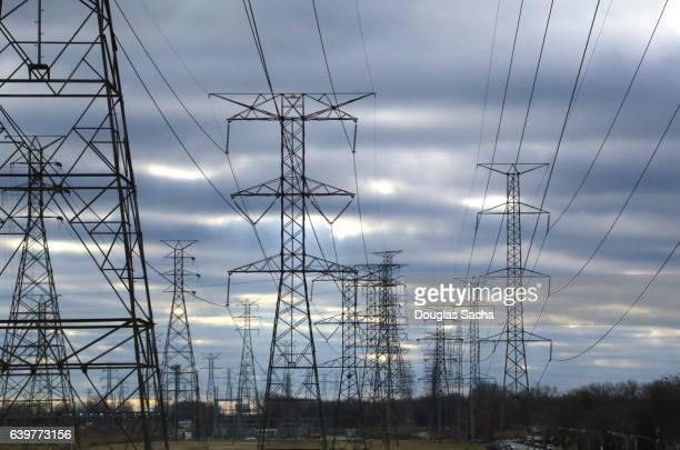 Multiple power lines on overhead towers