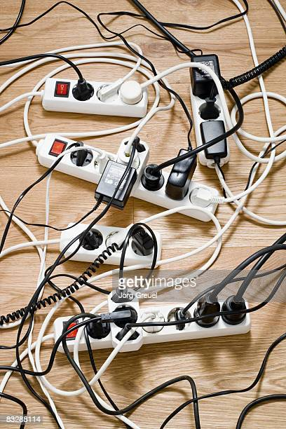 Multiple power strips on floor