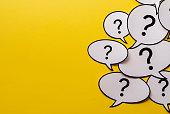 Multiple question marks in speech bubbles