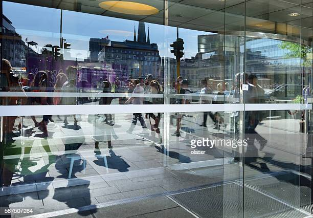 Multiple reflections, people on Sergels Torg, central landmark of Stockholm