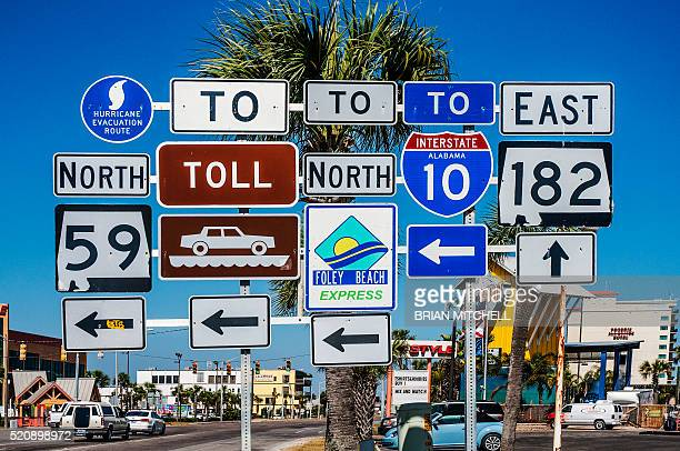 multiple road signs, gulf shores, alabama, usa - road sign stock pictures, royalty-free photos & images