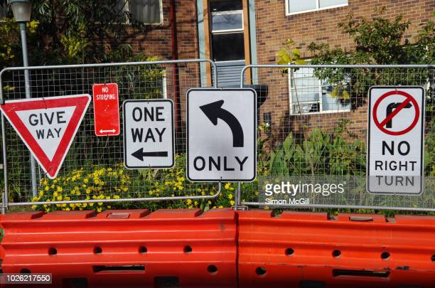 Multiple road signs near inner city road construction