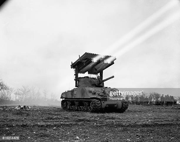 Multiple Rocket Launcher fires 45 inch rockets while mounted on an U S M4 #A3 tank in the Fletrage area of FranceIt is operated by the 134th Ordnance...