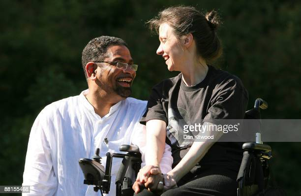 Multiple Sclerosis sufferer Debbie Purdy and her husband Omar Puente speak to the media at Victoria Tower Gardens on June 2 2009 in London England...