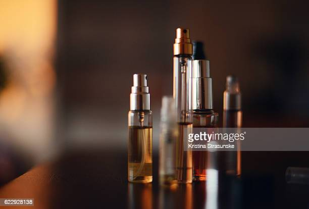 multiple small bottles of perfume