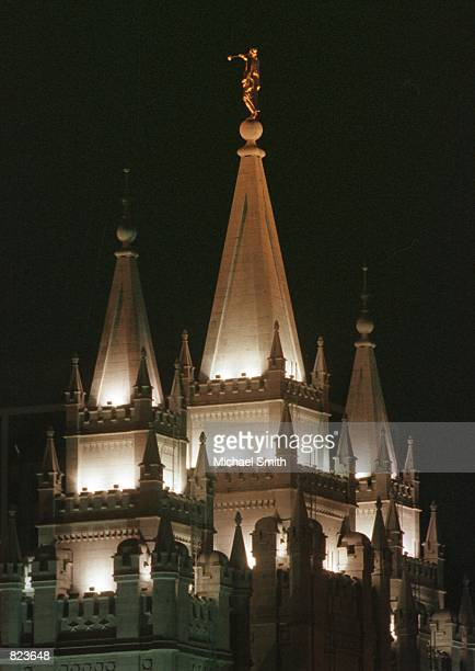 Multiple spires of the Mormon Temple are illuminated by glowing lights January 31 2001 in Salt Lake City UT The temple's highest spire reaching 210...