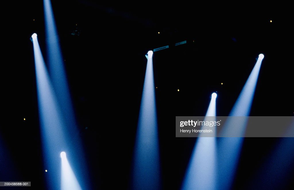 Multiple spotlights in dark room, low angle view : Stock Photo