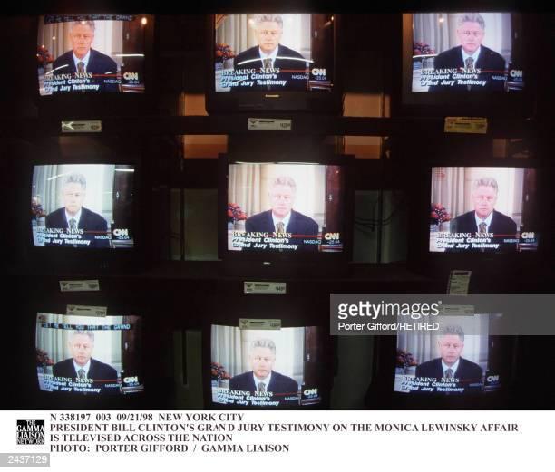 Multiple television monitors broadcast President Bill Clinton's Grand Jury testiomony on the Monica Lewinsky affair New York City September 21 1998