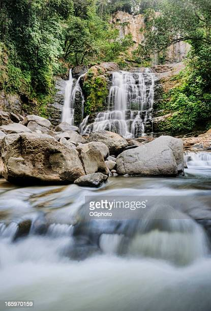 multiple tiered tropical waterfall - ogphoto stock photos and pictures