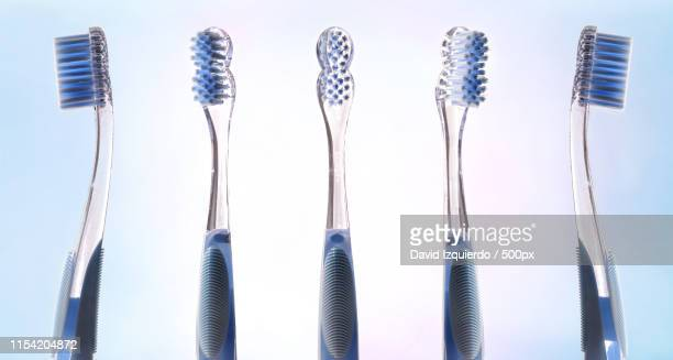 Multiple Views Of Transparent Blue Toothbrush
