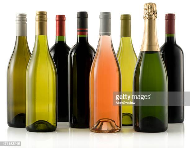 Multiple wine and champagne bottles