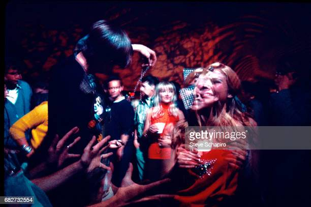 Multipleexposure image of young men and women as they dance at the Fillmore West nightclub San Francisco California 1967