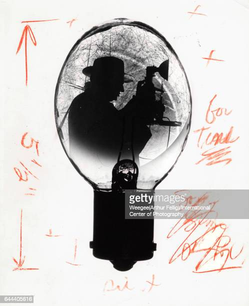 Multipleexposure image with a number of editorial markings shows a silhouette of American photographer Arthur Fellig known popularly as Weegee as...