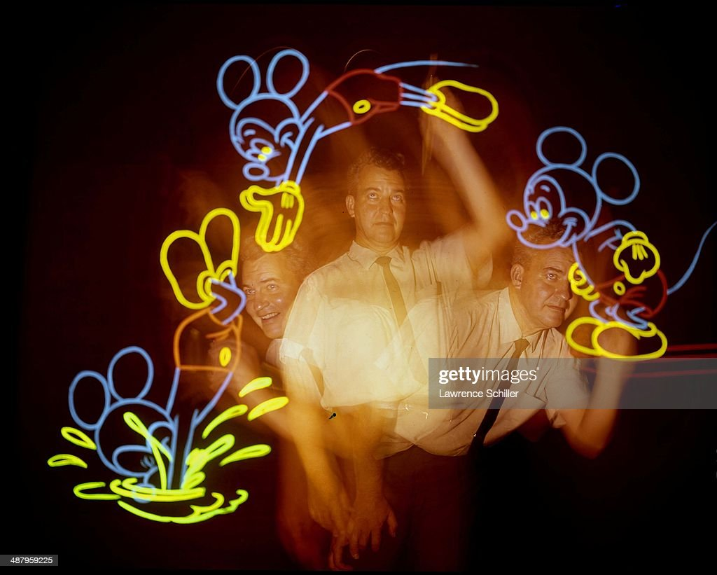 Multiple-exposure portrait of an unidentified animator and illuminated views of Mickey Mouse, Burbank, California, 1964.