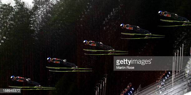 A multipleexposure sequence of Greogor Schlierenzauer of Ausria during the trial round for the FIS Ski Jumping World Cup event of the 61st Four Hills...