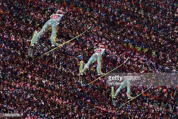 A multipleexposure sequence of Severin Freund of Germany is seen during the first round for the FIS Ski Jumping World Cup event of the 61st Four...