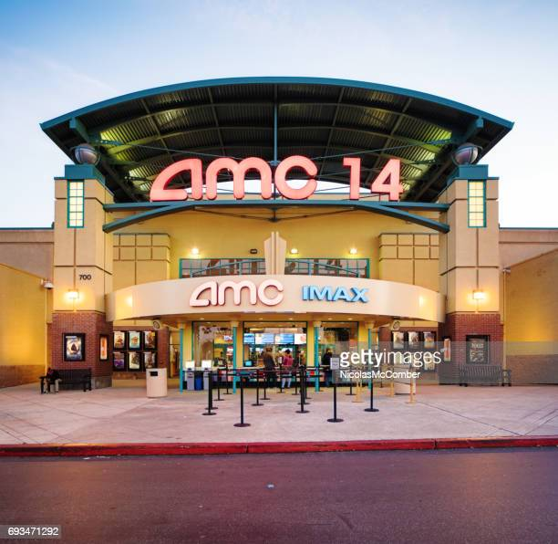 AMC multiplex movie theater entrance facade at sunset with sign