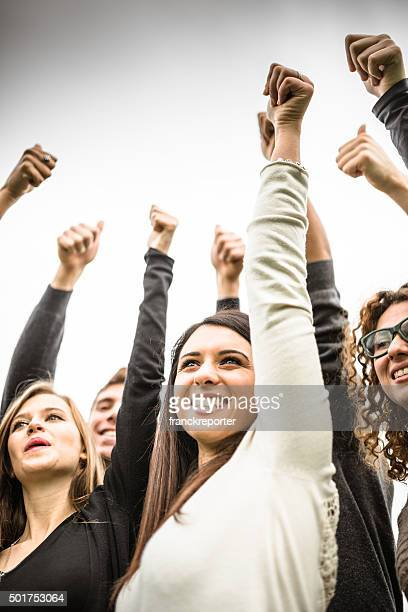 multiracial adult - thumbs up - votes for women stock photos and pictures