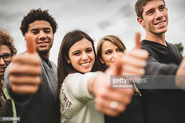 Multiracial adult - thumbs up