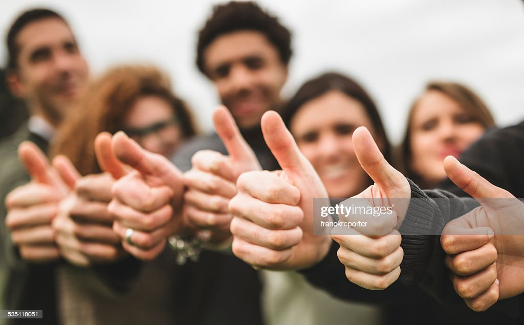 Multiracial adult - thumbs up : Stock Photo