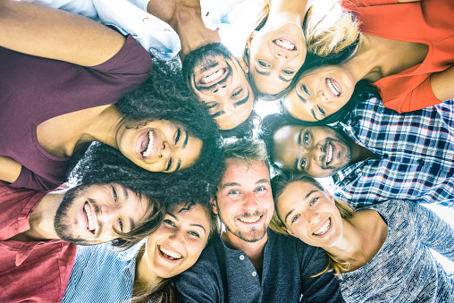 Multiracial best friends millennials taking selfie outdoors with back lighting - Happy youth friendship concept against racism with international young people having fun together - Azure filter tone 988594400