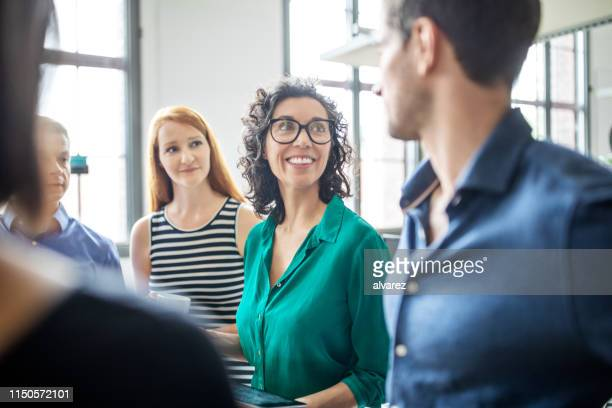 multiracial business people having meeting in office - discussion stock pictures, royalty-free photos & images