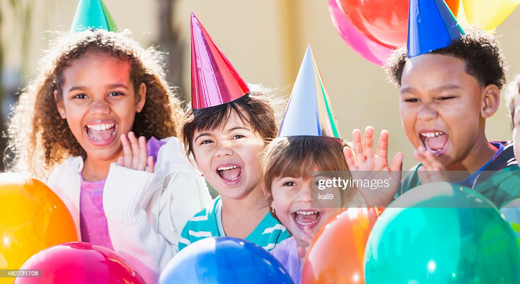 Multiracial children at a birthday party : Stock Photo