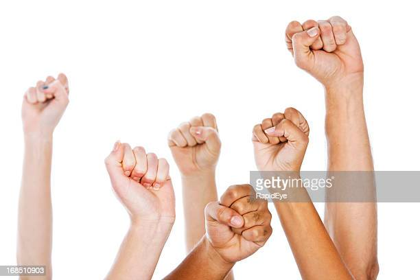 Multiracial clenched fists raised in the air against white background